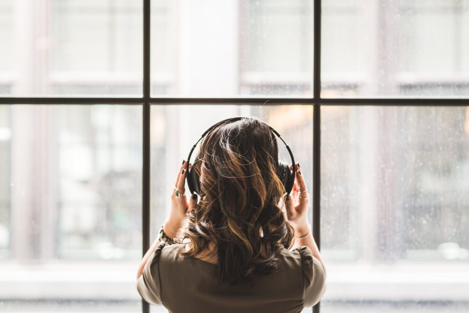 Girl with headphones at home
